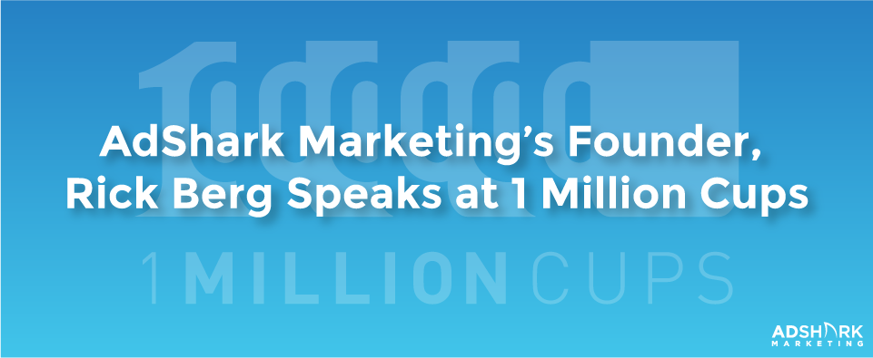 A blue image box with the text caption, 'AdShark Marketing's Founder, Rick Berg, Speaks at 1 Million Cups.'