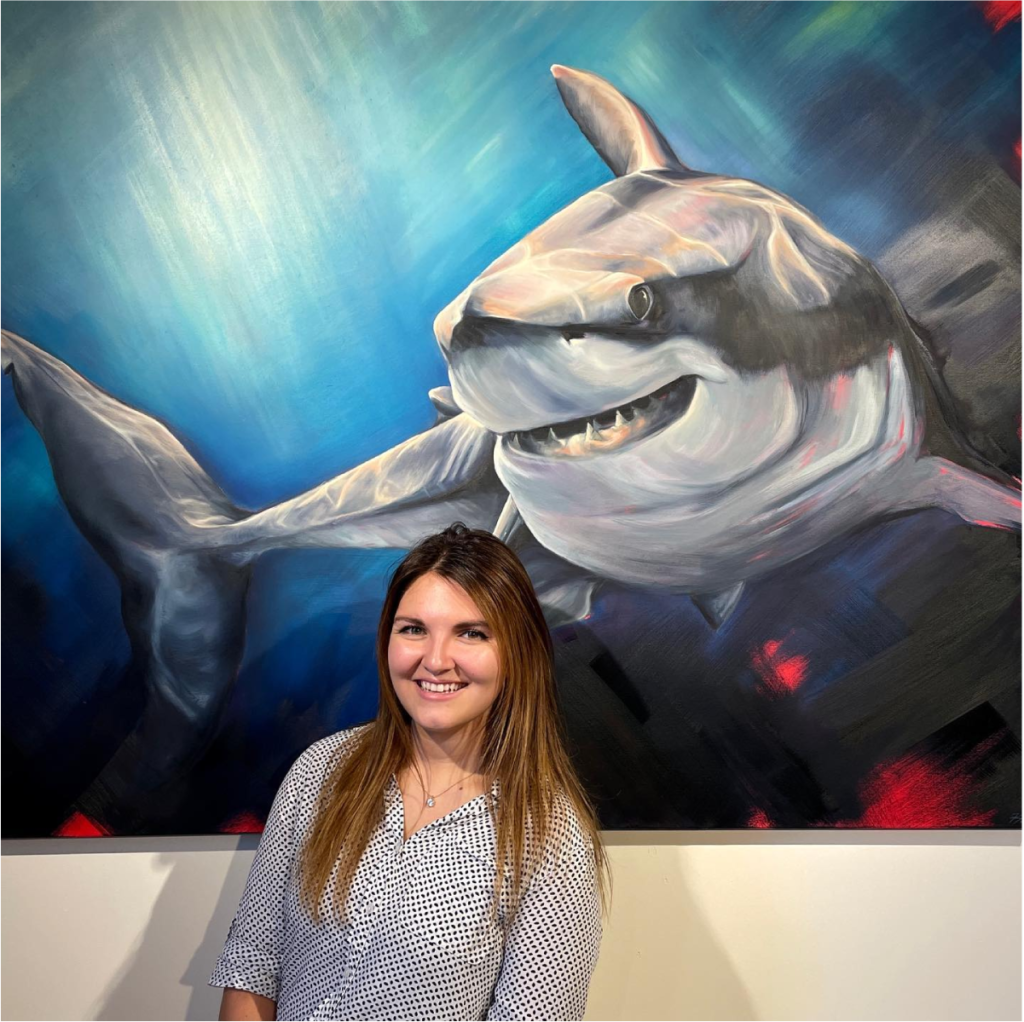 Artist Kayla Due presenting her painting to the AdShark team.